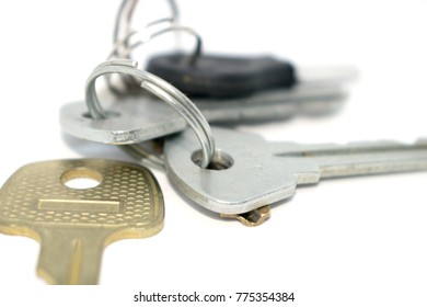 Bunch of keys. Photo of different keys from the door. On a white background.
