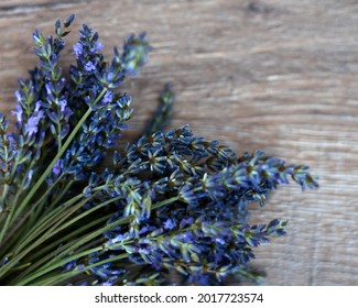 bunch of lavander on wooden background, selective focus. High quality photo