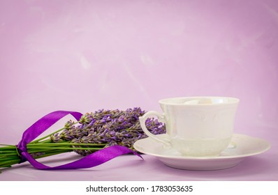 Bunch of lavender flowers isolated on  background and cup of cof