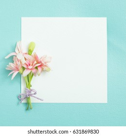 bunch of little lovely flower on white empty paper card over blue background for making card in mother's day, wedding invitation, anniversary or fill word in special occasionally