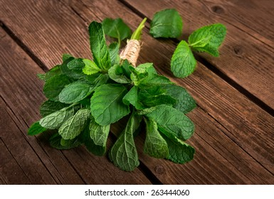 Bunch of mint on the wooden background