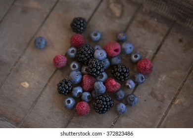bunch of mixed berries in a wooden basket