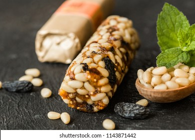 Bunch of mixed gluten free  energy bars with dried fruit & various nuts, concrete background. Healthy vegan super food, different fitness diet snacks for sporty lifestyl