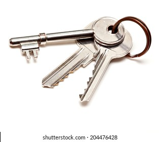 A bunch of modern door keys on ring on white background