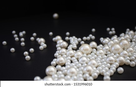 Bunch of multi size pearls on black background.Glamorous pearls milky-way.luxury lifestyle.Holiday decoration.Nice and shiny romantic morning.Love and success.