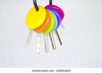 Bunch of multicolored keys on hand holding