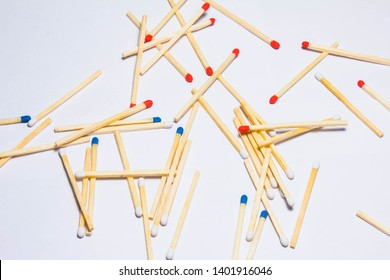A bunch of multi-colored matches with heads of sulfur in white, blue and red. Wooden matches for kindling fire. Flammable, fire prey, set on fire. Safety concept and causes of fire.