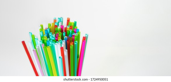 Bunch multicolour straws isolated on a white background. Greeting card to International Day Against Homophobia, IDAHOBIT.