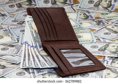 bunch of the new one hundred dollar bills and wallet