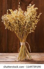 bunch of oat ears on wooden table