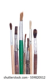 A bunch of old artistic brushes on white background isolated.