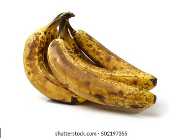 bunch of old bananas on white background