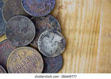a bunch of old copper and silver coins on board