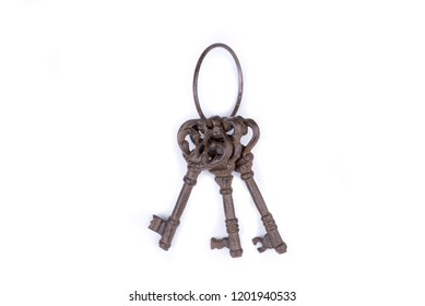 Bunch of old keys on white background. Old key laying on the background. Top view. Close up.