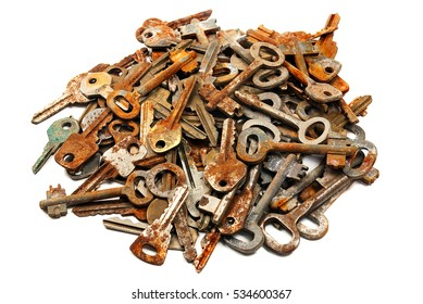 bunch of old rusty keys. Isolated on white background.