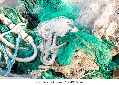 Bunch of old weathered trawl fishing net background