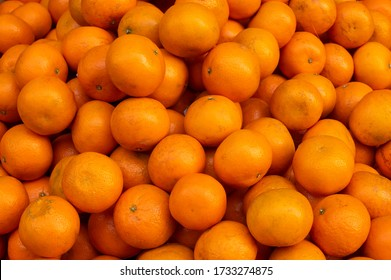 Bunch of Oranges or sweet orange fruits, scientific fruit family Rutaceae, are displayed for sale at New Market area, Kolkata, India.
