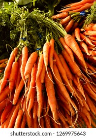 Bunch of organic carrots on a stall in Ferry Building Farmers Market in San Francisco, California, USA.