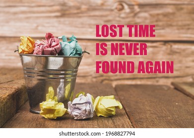 Bunch of paper waste on wooden board written with LOST TIME IS NEVER FOUND AGAIN