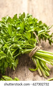 Bunch of parsley on rustic wooden table. Fresh vegetable.