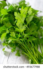 bunch of parsley on wooden surface