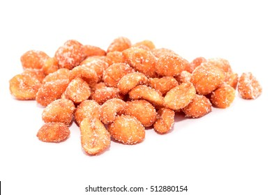 Bunch of peanuts with honey isolated on white