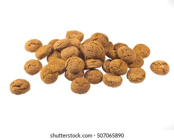 Bunch of Pepernoten cookies seen from side as Sinterklaas decoration on white background for dutch sinterklaasfeest holiday event on december 5th