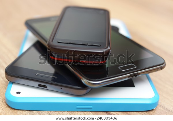 a bunch of phones and tablet computer