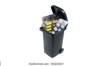 Bunch of pills in the trash bin