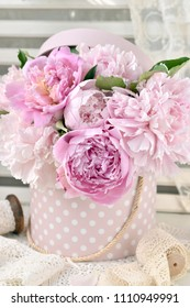 bunch of pink peony flowers in dotted box in shabby chic style interior