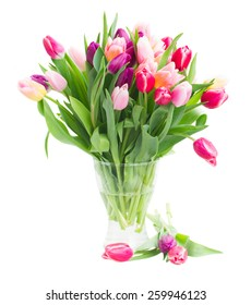 bunch of pink and purple  tulip flowers in glass vase   isolated on white background