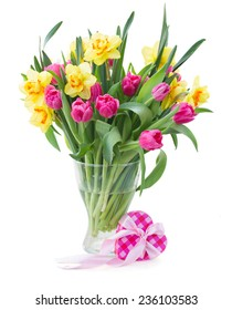 bunch  of pink tulip flowers and yellow daffodils in vase isolated on white background