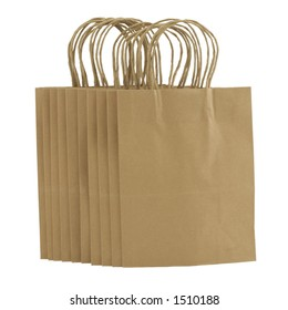 A bunch of plain brown paper shopping bags