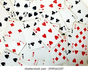 a bunch of playing cards on game table