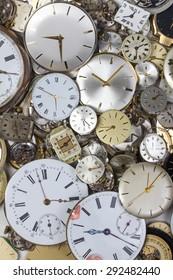 a bunch of pocket watch clockworks