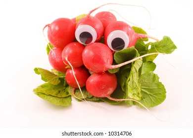 A bunch of radishes with a set of googly eyes sits on a white background.