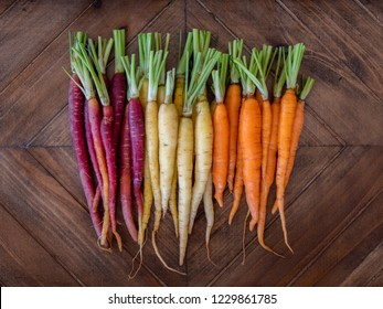 Bunch of rainbow carrots on serving tray arranged by color