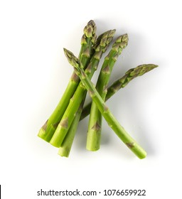 Bunch of Raw Garden Asparagus with Shadow Isolated. Fresh Green Spring Vegetables on White Background. Edible Sprouts of Asparagus Officinalis Top View