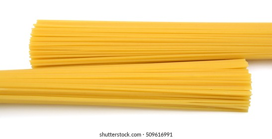 Bunch of raw spaghetti pasta, isolated on white background