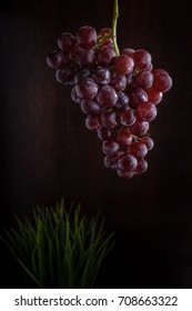 bunch of red grape with dark background