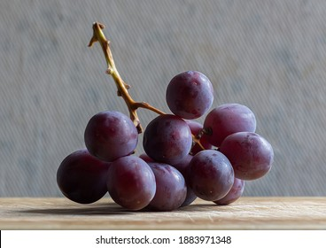 bunch of red grapes  on the stalk