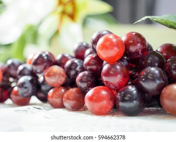Bunch of red grapes on white table