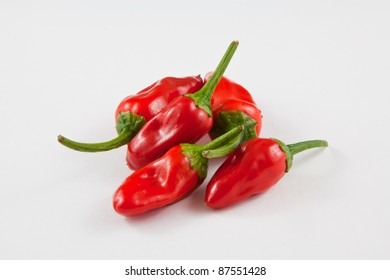 A bunch of red Jalapeno peppers, isolated on a white background.