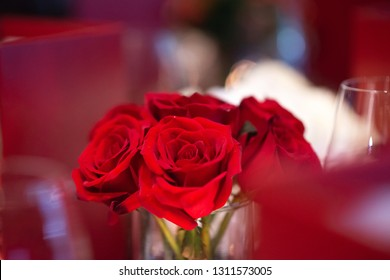 bunch of red roses decorate on fine dining table