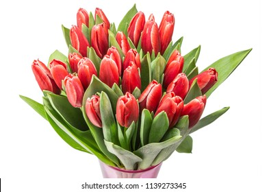The bunch of red tulips in a vase