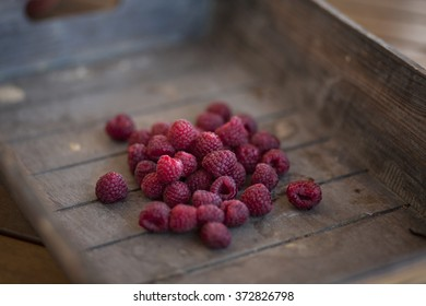 bunch of redberries in a wooden basket