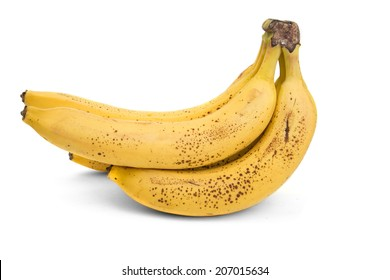 bunch of ripe bananas with dark spots on a white background