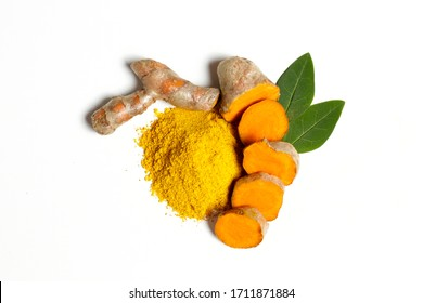 Bunch of ripe dried organic turmeric roots laid in composition on white background. Curcuma at table counter. Clean healthy eating concept. Background, close up, flat lay, top view.