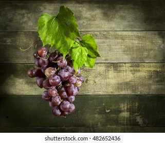 Bunch of ripe grapes with leaves.