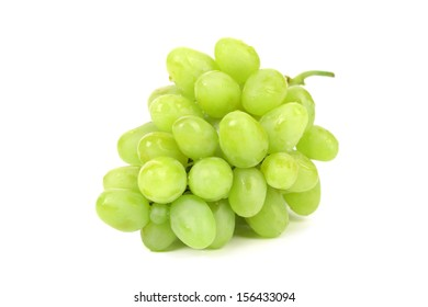 Bunch of ripe and juicy green grapes on a white background